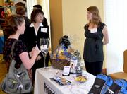 Kelly Schwedler with Professional Nursing Solutions chats with attendees during the 2012 Health Care Heroes Awards.