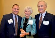 Health Care Award winner Rosemary Kenny, center, with past winner Shawn Van Steen, left, and her husband Neal Kenny.