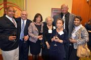 Health Care winner Annette Norris, fourth from left, along with her family and friends, from left, George Norris, Enoch Butler, LaGretta Butler, Mae Butler, Kenneth Norris and Janice Butler.