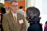 Craig Drake with Allscripts chats with another attendee during the health expo.