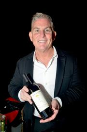 Steve Reynolds with Reynolds Family Winery poses with one of his wines.