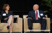 Janet Cowell, left, shares a thought with NCTA's Harvey Braswell.