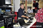 Bob Monaghan with FSI shows an attendee one of his laptops.
