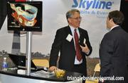 Scott Swanek with Skyline Exhibits & Events discusses his business with an attendee at the Triangle Business Growth Expo.