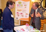 Coleman Alderson with My Trainer Fitness chats with Monsanto Company's Joshua Rameka.