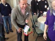 Valeri Bure with Bure Family Wines accepts his gift from one of the children.