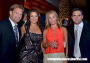 Carolina Hurricanes head coach Kirk Muller, left, along with guests at the Jimmy V Gala held at the Raleigh Convention Center.
