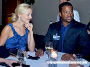 Fresh Prince of Bel Air star Alfonso Ribeiro, right, mingles with guests.