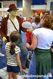 A mom and her daughter look over a life-size Lego sculpture of celluloid hero Indiana Jones.