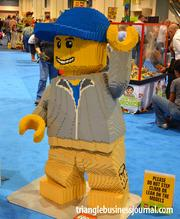 A Lego character made completely out of Legos greets attendees at the Kidsfest.