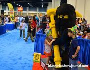 Kids pose next to a Ninjago character at the Lego Kidsfest.