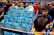 MiniFigures were a big hit with kids inside the Lego retail store. But it wasn't only kids enjoying the store ...
