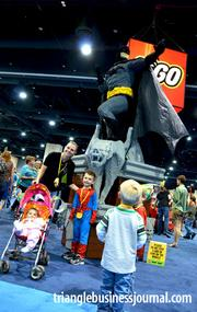 A full-sized Bat-Man stands above the crowd at the Lego Kidsfest.