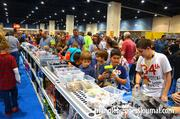 Kids shop through an assortment of Lego goodies inside the retail store.