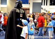 Most people would run and hide from the Dark Lord of the Sith, but these kids were anxious to get their picture taken with Darth Vader.