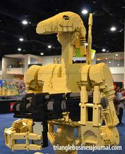 A Star Wars battle droid stands at attention at the Lego Kidsfest.