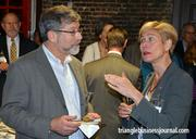 Jeffrey Leiter, a professor of sociology at NC State, mingles with State Rep. Deborah Ross.