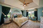 For this Savvy Homes property at 238 Country Mill Way in Fuquay-Varina, designer Sue Kemp teamed up with Edward Walker of HGTV's Trading Spaces decorator show to furnish and decorate this Parade model home. The home was designed by Savvy's in-house designer, Nancy Stoller.
