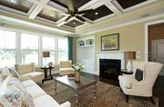 This Ashton Woods Homes property at 2605 Branston Way in Apex features a three-car side-load garage, stained coffered ceilings and a third floor media room.