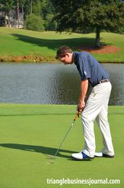 Prestonwood head pro Michael Carroll putts out on Highlands' No. 17.