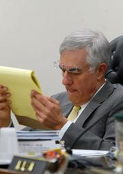 As chairman of the North Carolina Utilities Commission, Edward Finley has conducted three days of hearings on Johnson's ouster, questioning Rogers, Johnson and four other Duke Board members. Finley has suggested that Duke officials may have been less than fully forthcoming about their CEO plans in the weeks before they acquired Progress. He has also pointedly reminded witnesses that the commission has the authority to rescind its approval of the acquisition or even -- in what would be an unprecedented and highly controversial move -- demand that Johnson be reinstated as a condition for letting the merger stand. Finley has been on the commission since January 2007 and its chairman since July 2009. Like the other five commissioners, Finley serves by gubernatorial appointment for a four-year term. Previously, Finley represented utilities and utility customers before the commission as an attorney at Hunton & Williams, the same firm that Johnson once worked at.