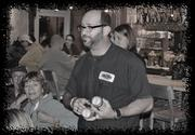 Bull City Burger & Brewery owner, Seth Gross, shares a ghostly story withthe members of the pub crawl.