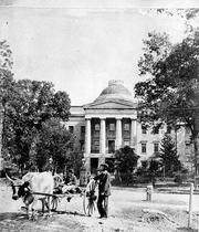 Here's a look at the old capitol, complete with an ox cart in front, from sometime in the early 1880s.