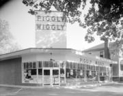 An old Piggly Wiggly is seen in this shot.