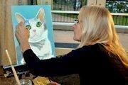 Artist Corneille Little paints a portrait of SPCA's spokescat, Riley.