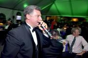 Auctioneer Leland Little works his skills during the live auction.