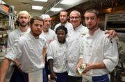 """""""These are the people that make me look good,"""" Second Empire Chef Daniel Schurr says of his cooking staff. Back row: Ben Kinol, James Lastinger and Micah Cook. Front row: Ben Trenary, Will Ashford, Executive Chef Daniel Schurr and Nevin Sexton."""