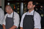 Chefs John Childers, left, and Christopher Hill wait for the announcement of the winner of battle tomato.