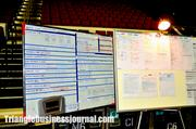 Behind the stage, several giant boards detail the performances for act 1 and 2 in Cirque du Soleil's Dralion.