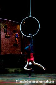 It takes great agility and strength to suspend from the aerial hoop.