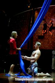 Several actors practice the Pas de Deux, an aerial dance performed with only a band of blue cloth.