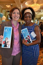 Winners Sarah Ford and Sherida McMullan pose with a 40 Under 40 program sporting their photos on the cover.