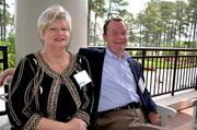 Kathy House and David Sanders enjoy a seat outside.