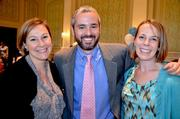 40 Under 40 winners Katie Kross and Ray Petrino, along with his wife Polly, pose for a photo.
