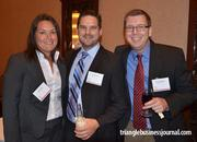 Laura Voss, Jon Tschudin and Peter Lehmann with Extrinsic LLC mingle at the Fast 50 awards ceremony.