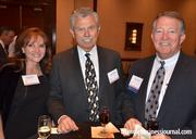 Lou Moshakos, center, with LM Restaurants enjoys a beverage before the Fast 50 event ceremony. He is joined by his wife, Joy, and CBRE's Butch Miller.