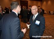 Rene Veilleux with BPI&E, right, has a conversation with Bank of America's Keith Erazmus.