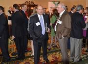 Rivers Lee of Senn Dunn, left, and Tommy MacNeill of Centurion Construction talk at the 2012 Space Awards.