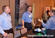 Christian Rich and John Jessup, left to right, with NC Propane Gas Association discuss their business with an attendee at this year's TBJ Green Awards.