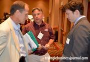 Tim McConnell with Ruston Paving, center, holds down a conversation with Bruce Roach, left, and John Thrush, right, of Brightleaf Consulting Group.