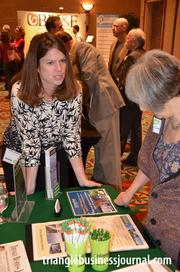 Kathy Hughes with NC GreenPower talks shop with a Green Expo attendee.