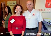 Evelyn Contre with Springleaf Strategies and Stew Miller with Yes! Solar Solutions pause for a photo at the expo.