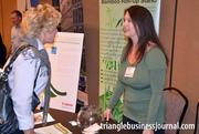 Angie Conklin, right, with Accent Imaging talks energy efficiency with a fellow expo attendee.