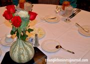 The handmade table displays were a creative assortment of flowers and hollowed out gourds.