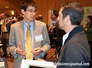 Charles Adair, left, with NC Sustainable Energy Association, talks green with a fellow attendee.