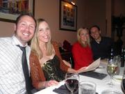 919 Marketing employees Stacey Hilton, second from left, and Brian Hugins, far right, enjoy dinner with their better halves at a Christmas party at Caffe Luna.